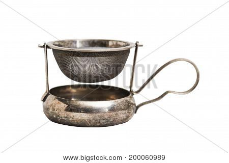 Steel shiny old vintage scratched shabby tea strainer with metal saucer and delicate thin handle on isolated white background.