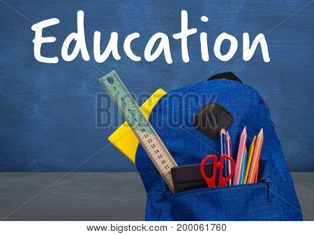 Digital composite of Schoolbag on Desk foreground with blackboard education text