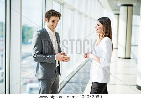 Smiling Colleagues Meeting Speaking Together In An Office