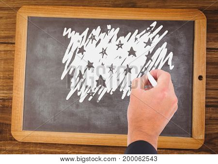 Digital composite of Hand drawing stars on blackboard