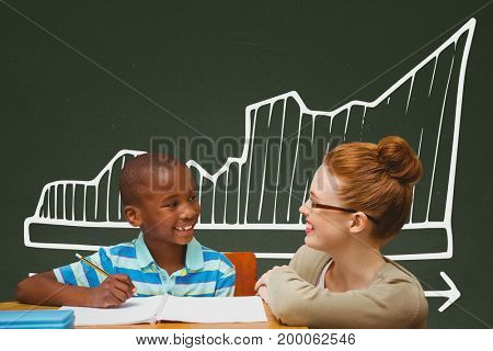 Digital composite of Student boy and teacher at table against green blackboard with school and education graphic