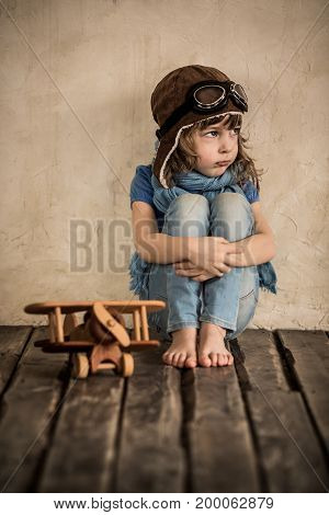 Sad Child With Toy Wooden Airplane