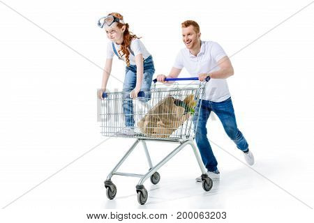 Father And Daughter With Shopping Trolley