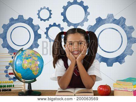Digital composite of Schoolgirl at desk with settings cog gears