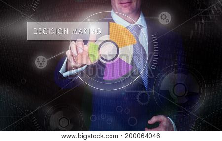 A Businessman Selecting A Decision Making Button On A Computerised Display Screen.