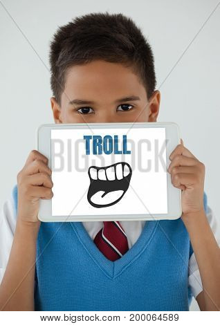Digital composite of Troll text with cartoon mouth on tablet over boys face