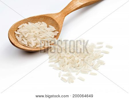Wooden spoon with parboiled rice isolated on white background. Healthy food. Close up. High resolution product