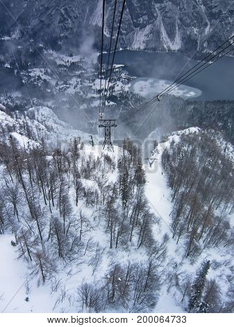High speed ropeway between mountain Vogel and lake Bohinj in winter, Triglav national park, slovenian alps, Slovenia