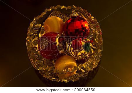 Christmas shiny colored decorations in a glass bowl prepared for christmas tree