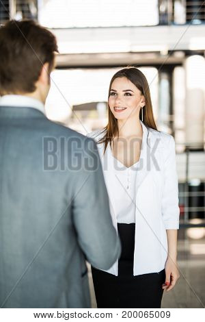 Business Handshake - Two Businesspeople Shaking Hands To Conclude Deal Or Agreement. Business Concep