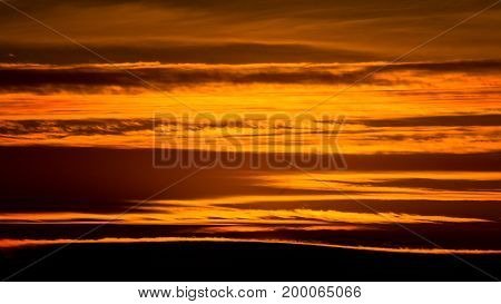 Abstract patterns and texture of golden clouds at sunset over Belgrade, Serbia