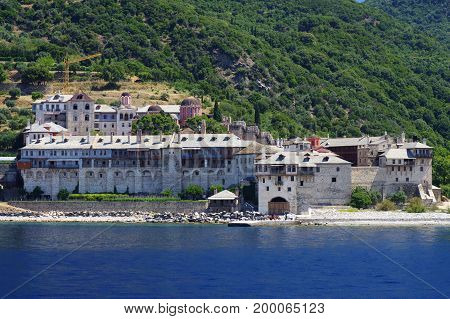Athos peninsula, Greece. Xenofontos Monastery located in the Monks Republic on the peninsula of Athos. View from a cruise ship.