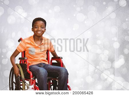 Digital composite of Disabled boy in wheelchair with bright sparkling bokeh background