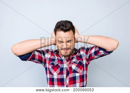 Noo! Stop! Close Up Of A Stressed Young Brunet Man With Closed Eyes And Struggle Grimace. He Is In A