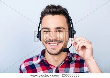 Successful Young Man Operator Of A Online Hot Line Customer Representative Is Smiling, Wearing A Hea
