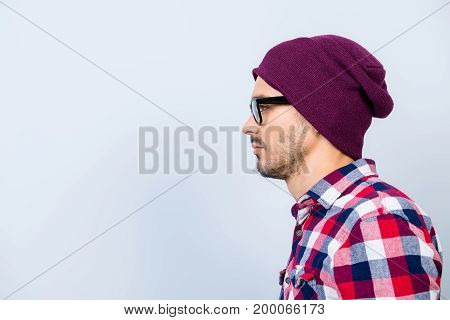 Profile Side Photo Of Young Serious Hipster Guy In Hat, Glasses, With Stubble, In Casual Outfit On P