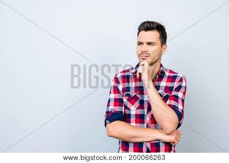 Skeptic, Unsure, Uncertain, Doubts Concept. Young Guy In Checkered Casual Wear Is Looking Sceptical,