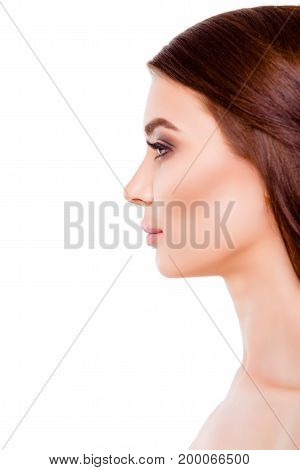 Close Up Cropped Side Profile Portrait Of Young Pretty Lady With Smooth Skin And Healthy Brown Hair,