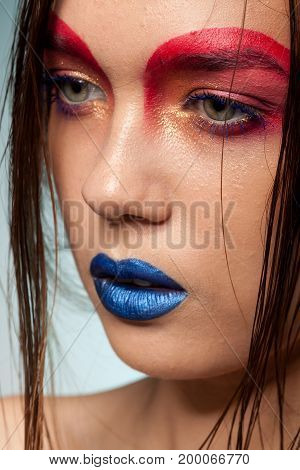Portrait of beautiful young model with creative make up and hairstyle. Beauty and fashion. Artistic on stage make up