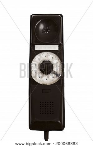 Old vintage stationary shiny leather brown plastic telephone with a tube on the wire with a cord on isolated white background