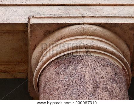 Fragment of a column in the antique style. Architectural background. Doric order. Column.