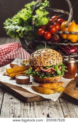 Hamburger with meat, tomato, salad and onion, selective focus, retro style