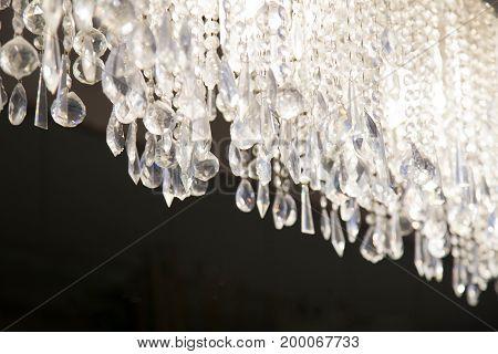 Chrystal chandelier close-up. Chandelier design glass .