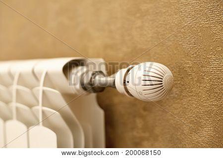 Heating radiator with temperature regulator . White radiator