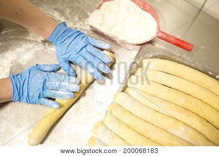 Female baker hands making baking . Fresh bake