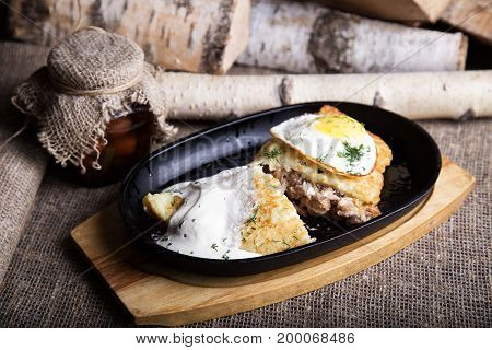 Tasty potato pie  with meat and egg.