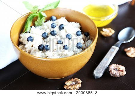 Porridge with bilberry, honey and walnuts.  Healthy food