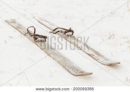 Pair of old skis on the snow .