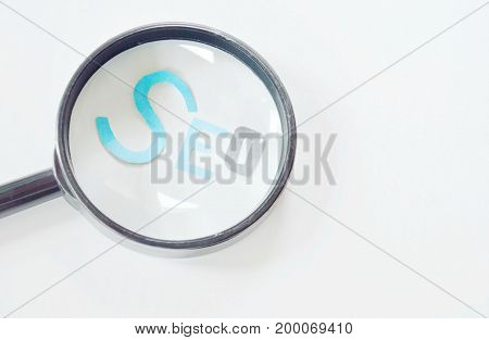 magnifying glass view on SEO paper cut letter on white background