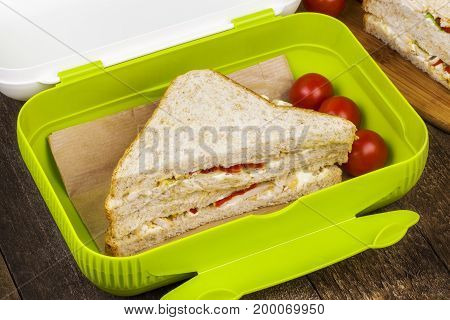 Sandwiches in food box in room .