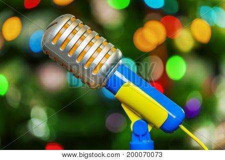 Karaoke toy microphone on bokeh in room