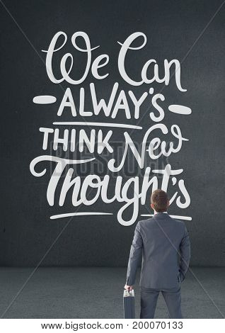 Digital composite of Business man standing in front of a motivational text