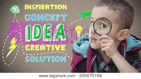 Digital composite of Boy holding magnifying glass next to colorful creative concept idea graphics