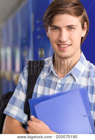 Digital composite of male student holding files in front of lockers