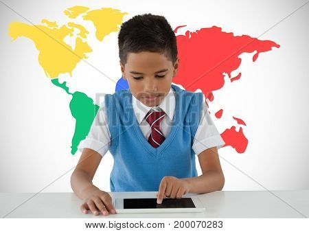 Digital composite of Schoolboy on tablet with colorful world map