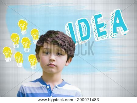 Digital composite of Boy in front of colorful idea and light bulb graphics