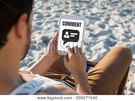 Digital composite of Comment text and chat graphic on tablet screen with mans hands