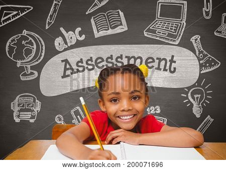 Digital composite of Happy student girl at table against grey blackboard with assessment text and education and school gr