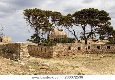 The panoramic view of the old castle on a cloudy day (Greece, island Crete)