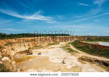 Limestone mining in a quarry, yellow quarry landscape