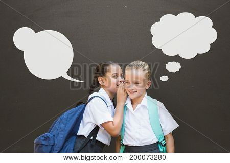Digital composite of Student girls with speech bubbles whispering against grey background