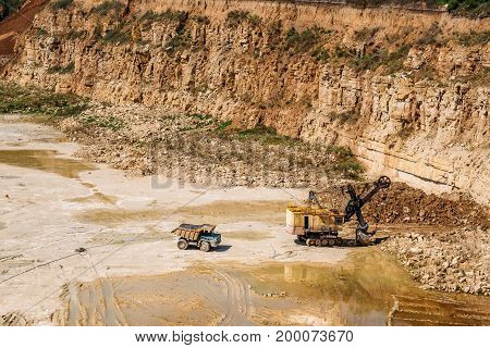 Heavy duty machines work in a quarry, quarry equipment concept, copy space