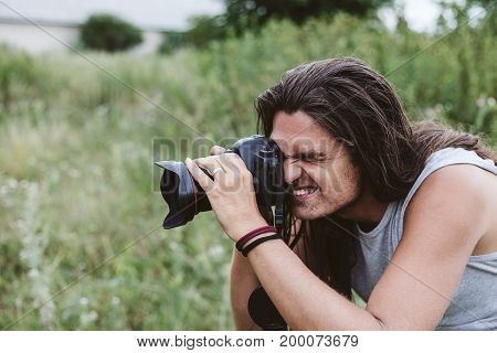 Traveler nature photographer with camera, copy space