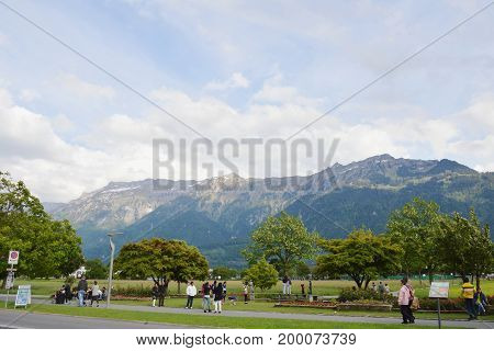 Interlaken Switzerland June 1, 2014 : tourist photo and relaxing at the park in Interlaken city