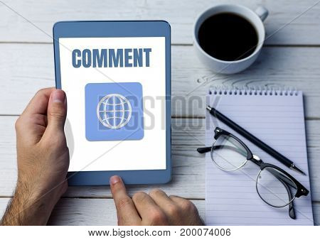 Digital composite of Comment text and world graphic on tablet screen with hands
