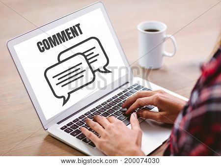 Digital composite of Comment text and chat graphic on laptop screen with hands
